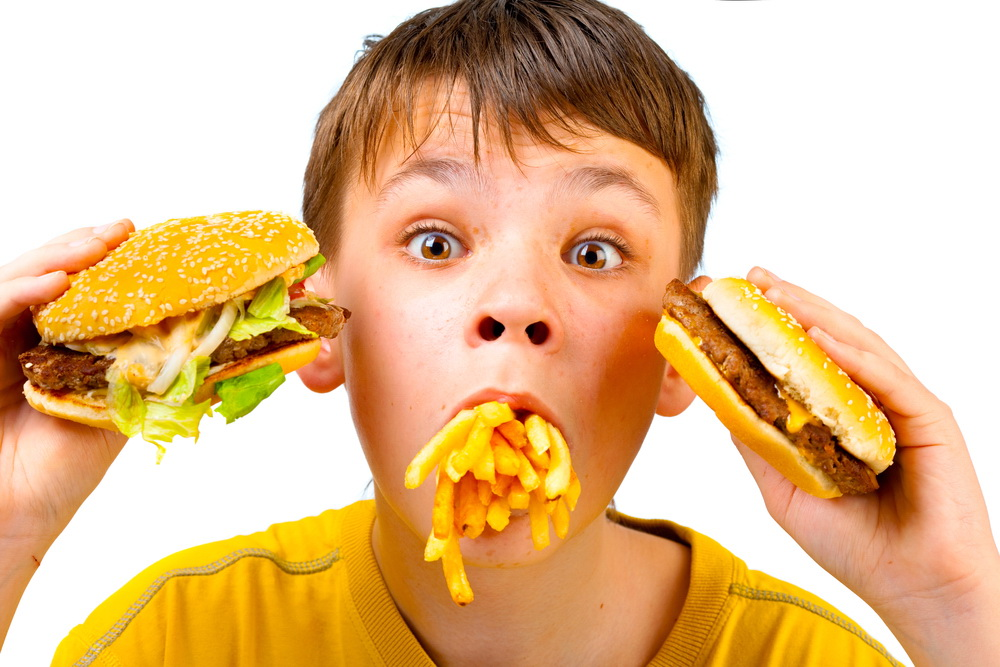 Boy with meal in a mouth