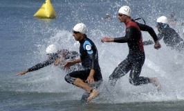 050625-N-7575W-011 Point Mugu, Calif. (June 25, 2005) - Sylvain Dodet, front left, from France, and Bas Borreman, right, from the Netherlands, along with other tri-athletes, dash into the sea to begin their 1.5 kilometer swim during the 12th annual World Military Triathlon. The triathlon held at Naval Base Ventura County, consisted of a 1.5 kilometer swim, 40 kilometer bike ride and a 10 kilometer run, was held June 25, at Naval Base Ventura County. U.S. Navy photo by PhotographerÕs Mate 2nd Class Jason R. William (RELEASED)