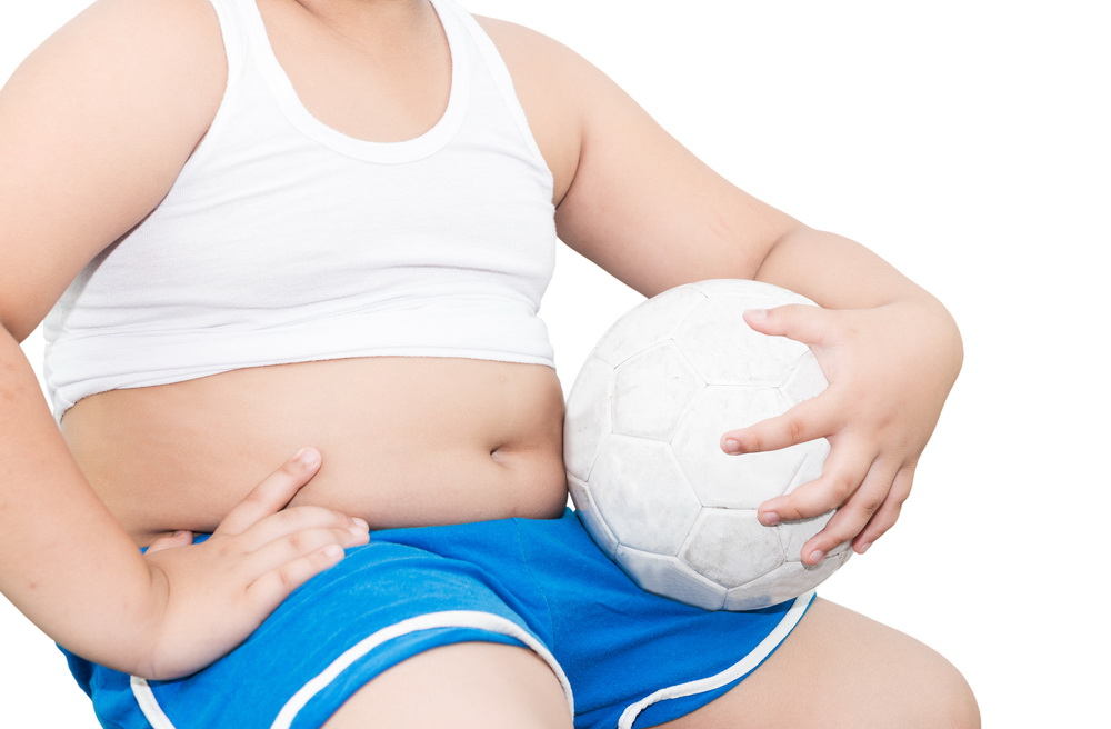 fat boy hold football isolated on white background
